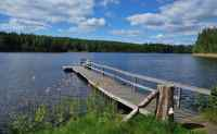 Beautiful finnish lake with wooden platform for swimming and fishing